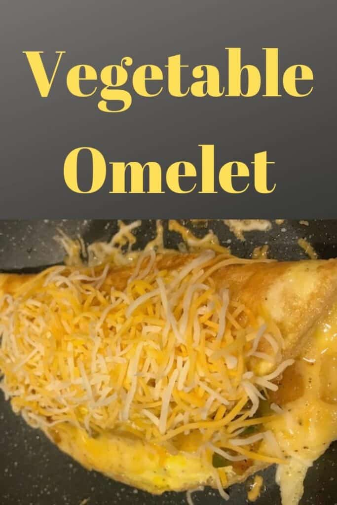Vegetable omelet topped with shredded cheese