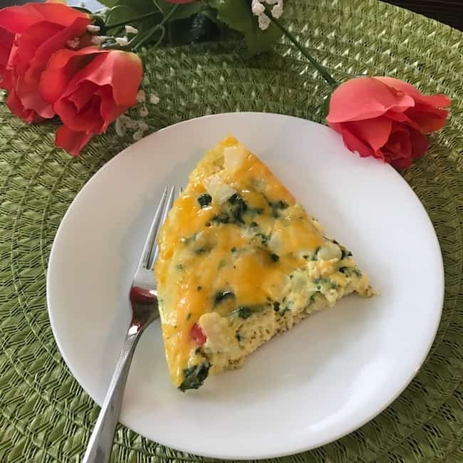Slice of vegetable frittata on a plate