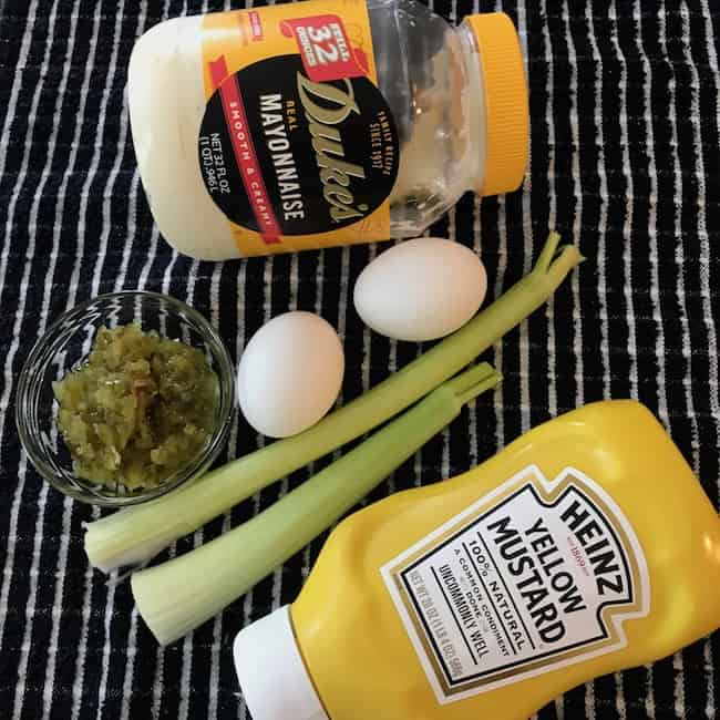 Mayonnaise, eggs, celery, sweet pickle relish, and mustard