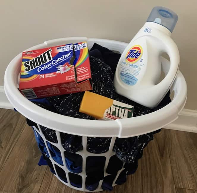 Basket with dirty clothes, detergent, stain remover, and Color Catcher