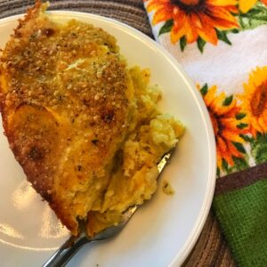 Fork of squash casserole on a plate