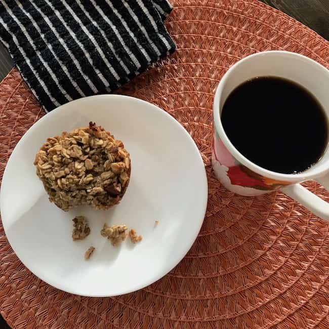 Apple oat muffin and a cup of coffee