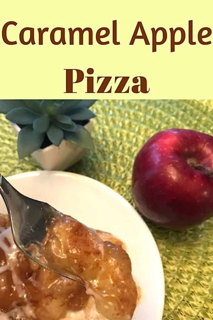 Bite of caramel apple pizza with apple