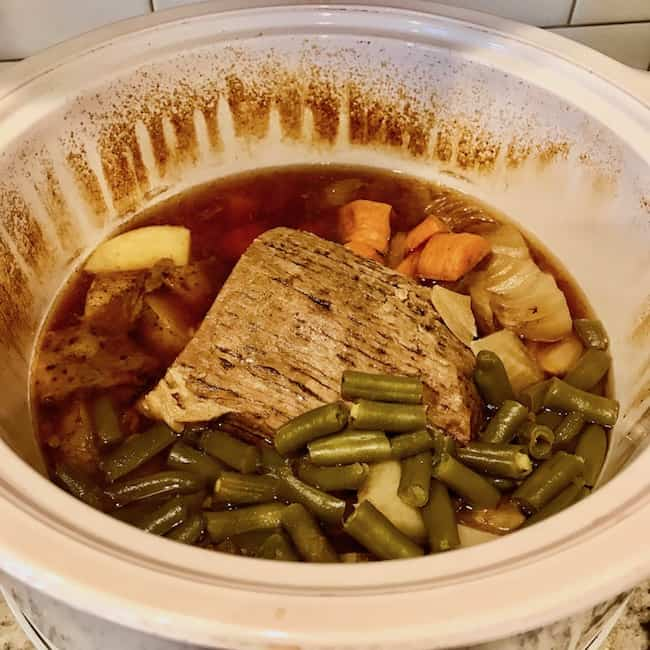 Cooked roast and vegetables still in the pot