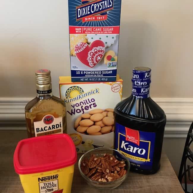 Powdered sugar, vanilla wafers, rum, corn syrup, cocoa powder, and pecans