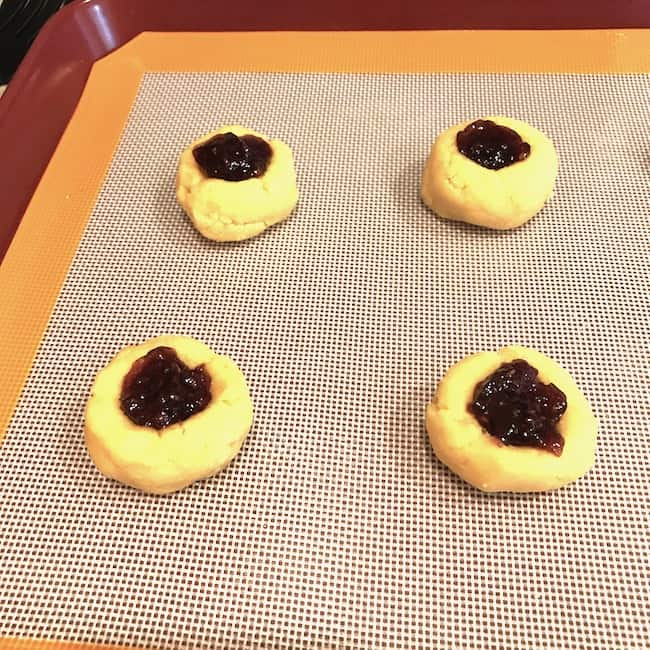 Prebaked filled thumbprint cookies