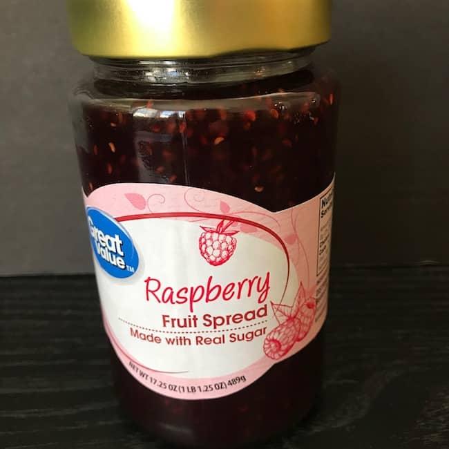 Jar of raspberry fruit spread