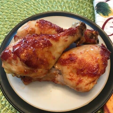 3 chicken legs on a plate