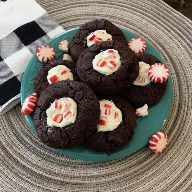 Chocolate peppermint thumbprint cookies and candy on a plate