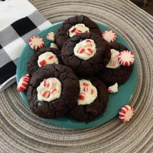 Chocolate peppermint thumbprint cookies and candies on a plate