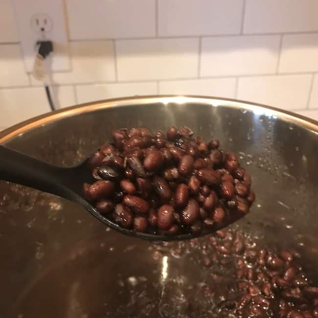 Spoon of cooked black beans