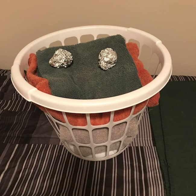 Laundry basket with foil balls