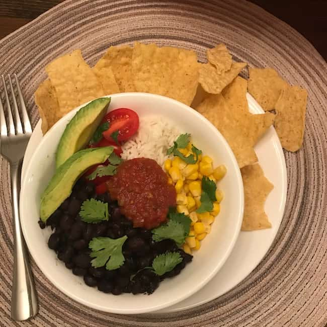 Black beans with rice, corn, avocados, tomatoes, and salsa