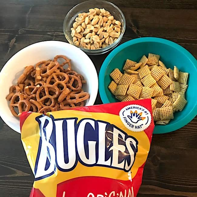 Pretzels, peanuts, Chex, and bugles for the sweet and salty snack mix