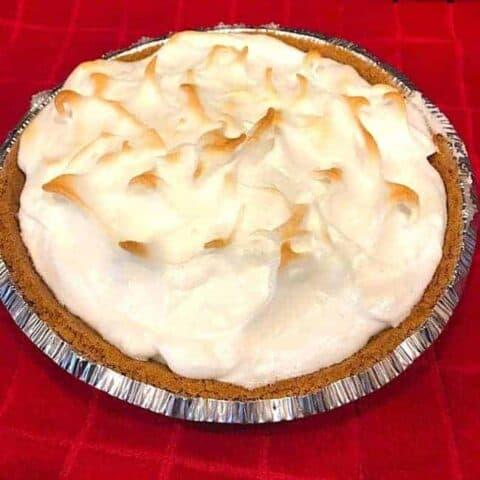 Whole lemon meringue pie with a graham cracker crust