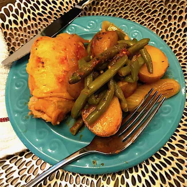 Chicken and Vegetables on a plate with a fork