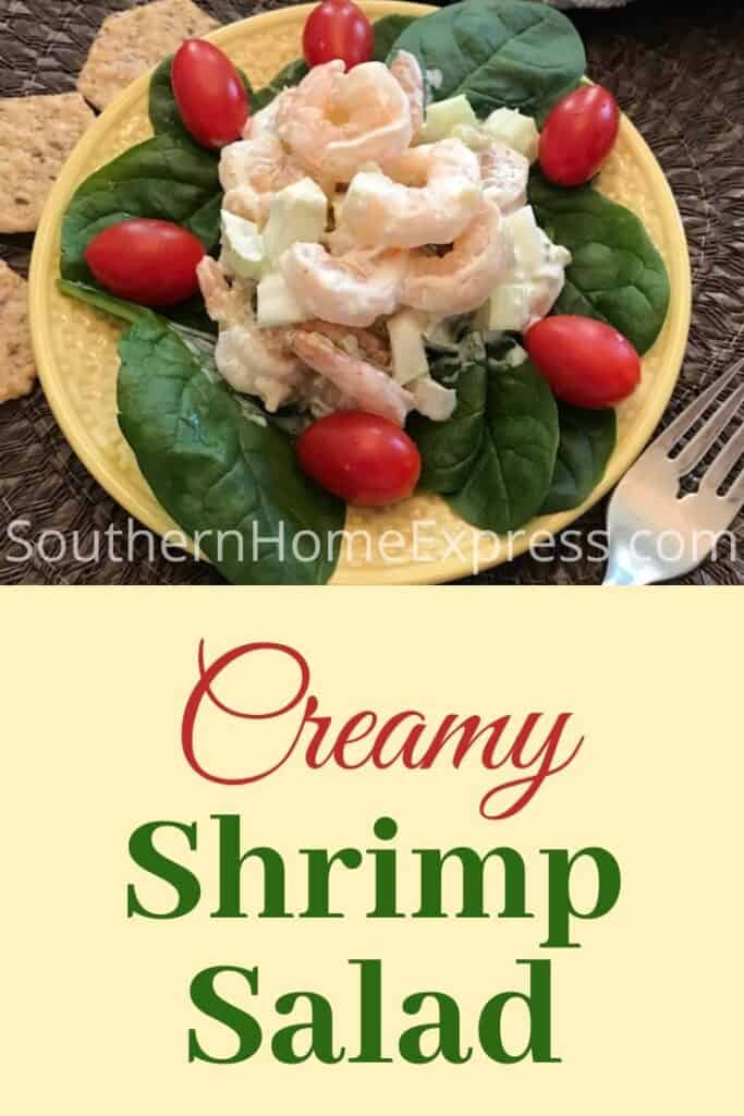 Creamy shrimp salad on a bed of spinach leaves and tomatoes