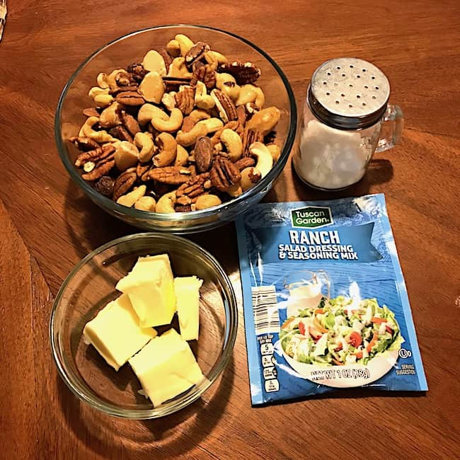 Bowl of mixed nuts, salt, butter, and ranch dressing mix