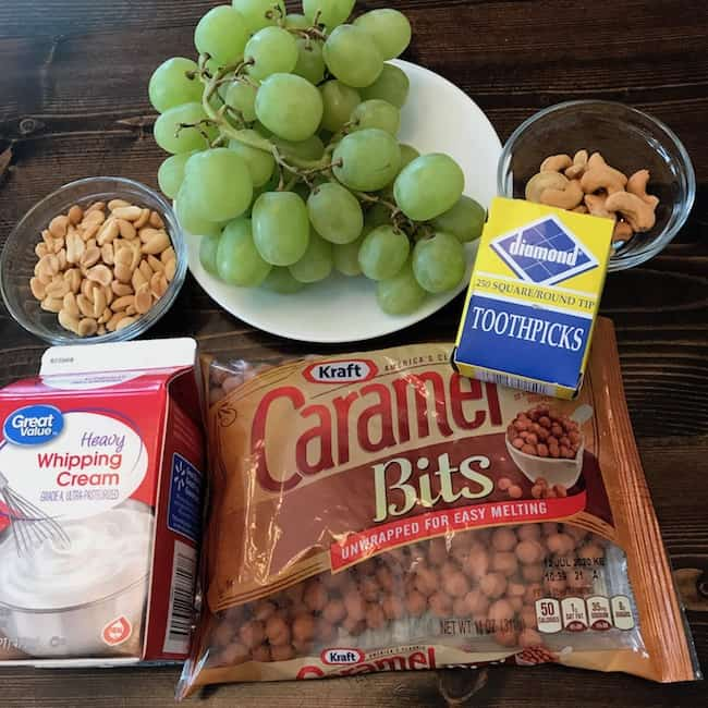 Grapes, caramel bits, whipping cream, nuts, and toothpick