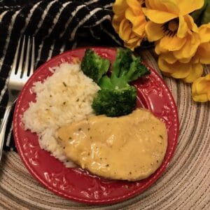 Pork chop dinner with rice, gravy, and broccoli