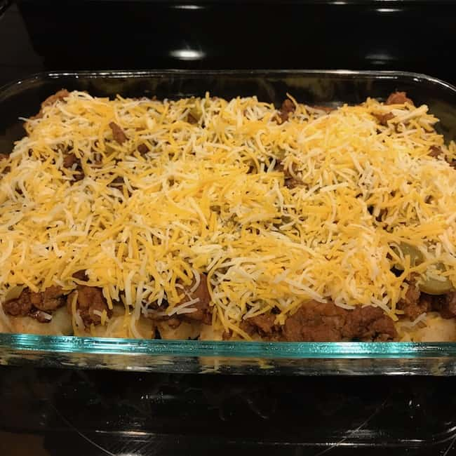 Cheese sprinkled over Tater Tot taco casserole