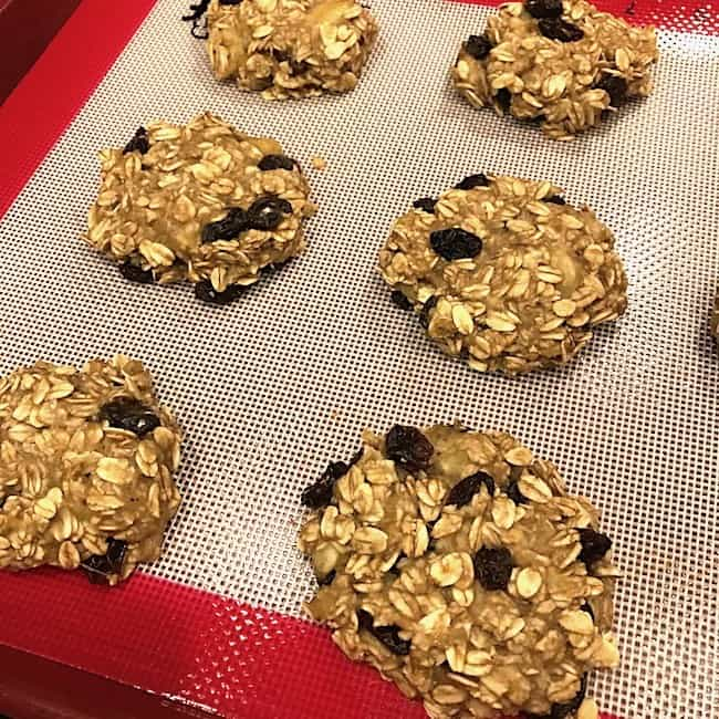 Baked 3-ingredient breakfast cookies on a cookie sheet