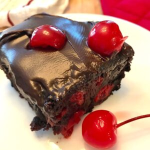 Slice of cherry chocolate cake on a plate