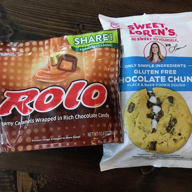 Package of chocolate chip cookie dough and a bag of Rolo candies