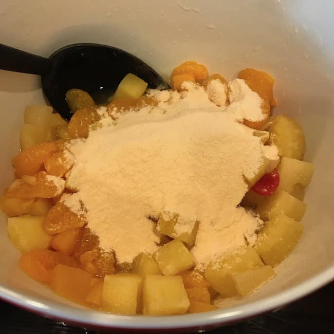 Pudding mix sprinkled over the fruit