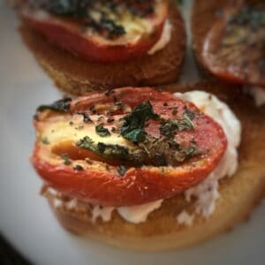 Roasted tomato on toast with cream cheese
