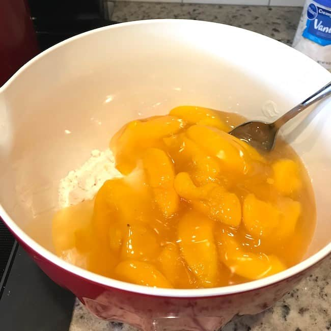 Peach pie filling in the bowl with cake mix