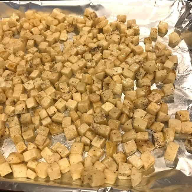 Seasoned potatoes on a pan