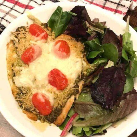 Parmesan pesto tilapia and salad on a plate