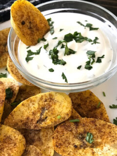 plate of plantain chips with a bowl of dip