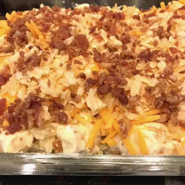 Bacon bits sprinkled on top of the Tater Tot casserole