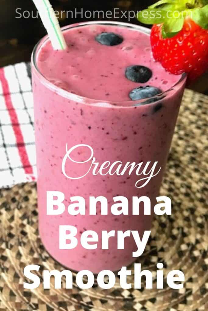 Banana berry smoothie with a strawberry and blueberries on top