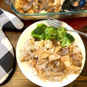 Chicken and rice casserole on a plate with broccoli
