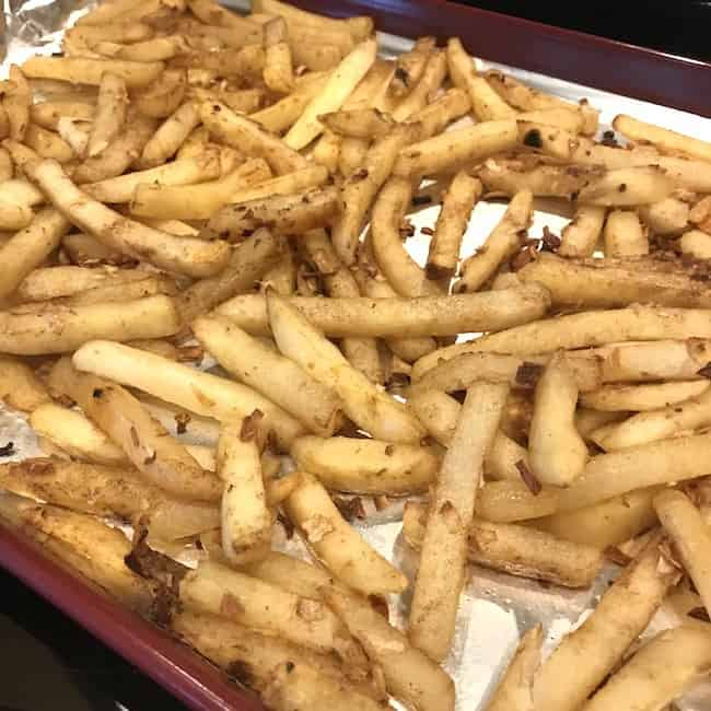 Cooked fries on a baking sheet