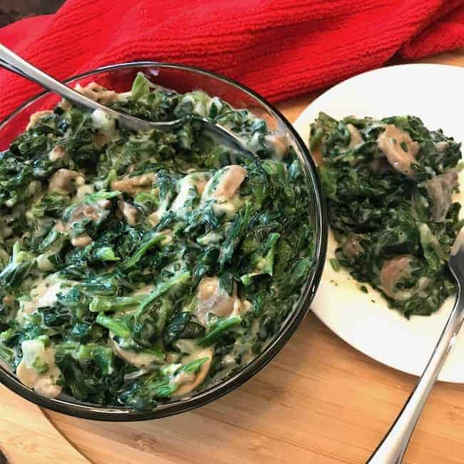 Bowl and plate of creamed spinach with mushrooms