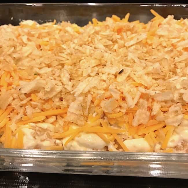 Crushed potato chips sprinkled over the cheese