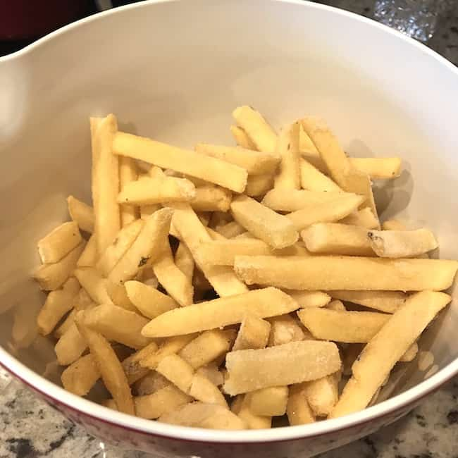 Uncooked fries in a large bowl