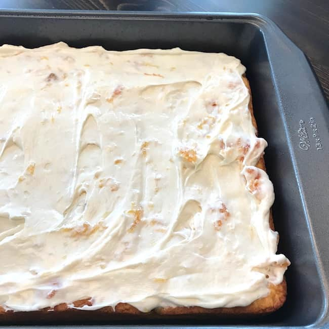 Cake with vanilla and peach frosting