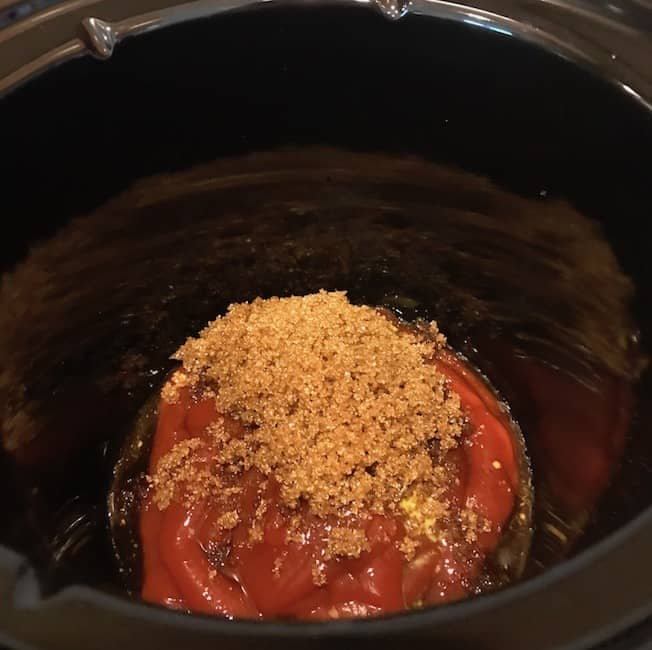 Brown sugar added to the mixture in the crockpot
