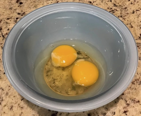 2 cracked eggs in a bowl
