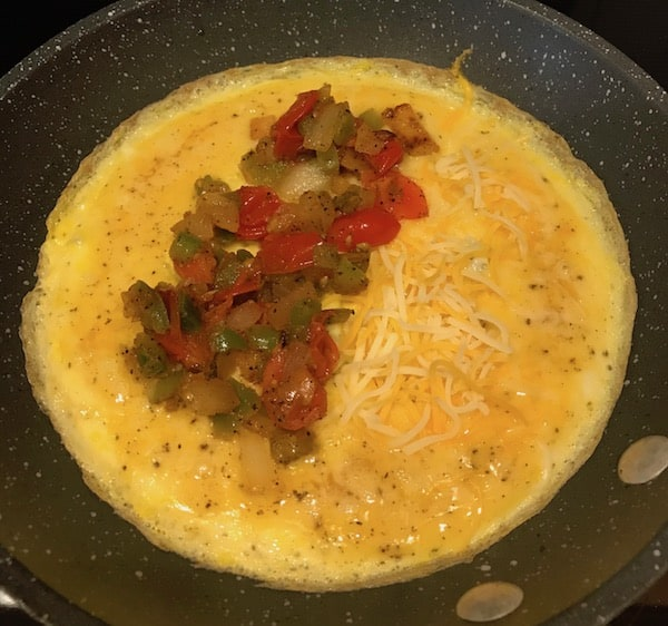 Omelet with vegetables and cheese added