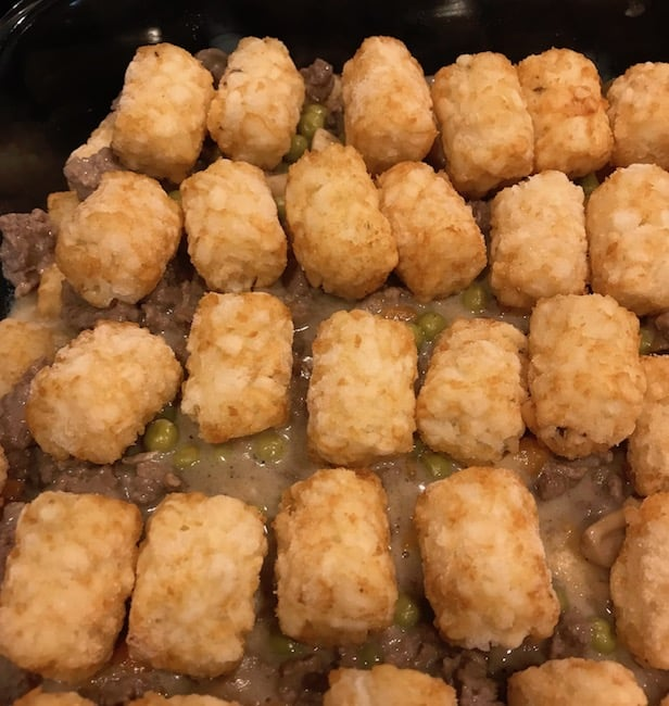 Top layer of Tater Tots over casserole