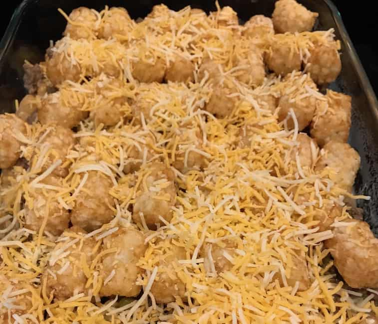 Shredded cheese over the rest of the casserole ingredients