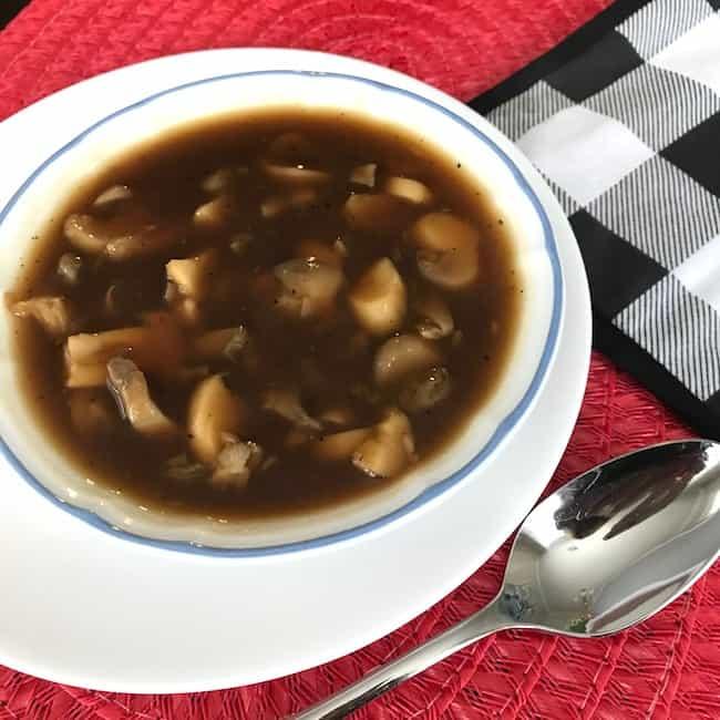 Bowl of quick gluten-free gravy with mushrooms