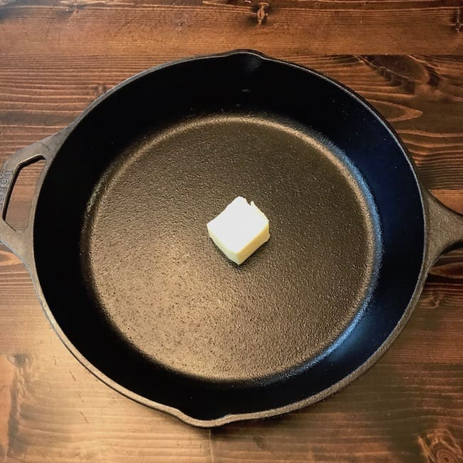 Pat of butter in the center of a cast iron skillet