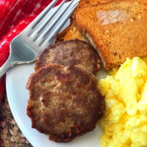Plate with turkey sausage, eggs, and toast